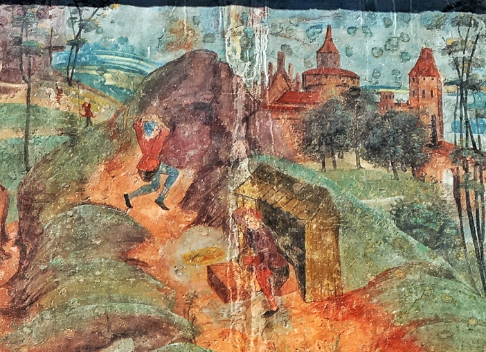 Eines der Fresken an der Südseite der Pfarrkirche zeigt Bergknappen bei der Arbeit.